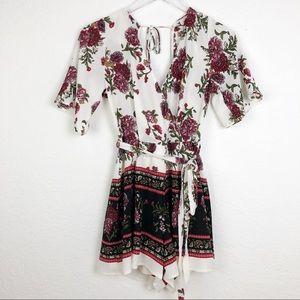 Francesca's | Floral Faux Wrap Tie Back Romper M